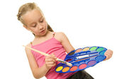 Beautiful little girl with a paintbrush — Stock Photo