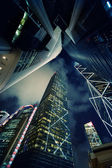 Modern skyscrapers at night time — Stock Photo