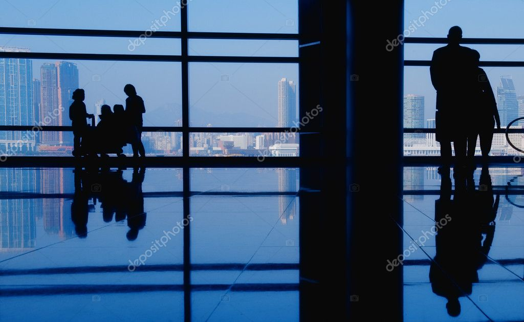 Modern building and silhouettes  Stock Photo #1420796