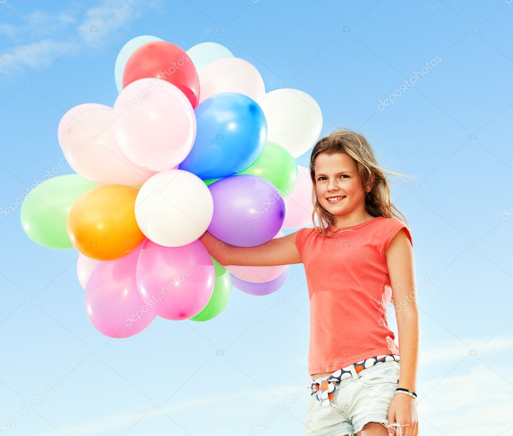 Happy girl with colorful balloons — Stock Photo #1420998