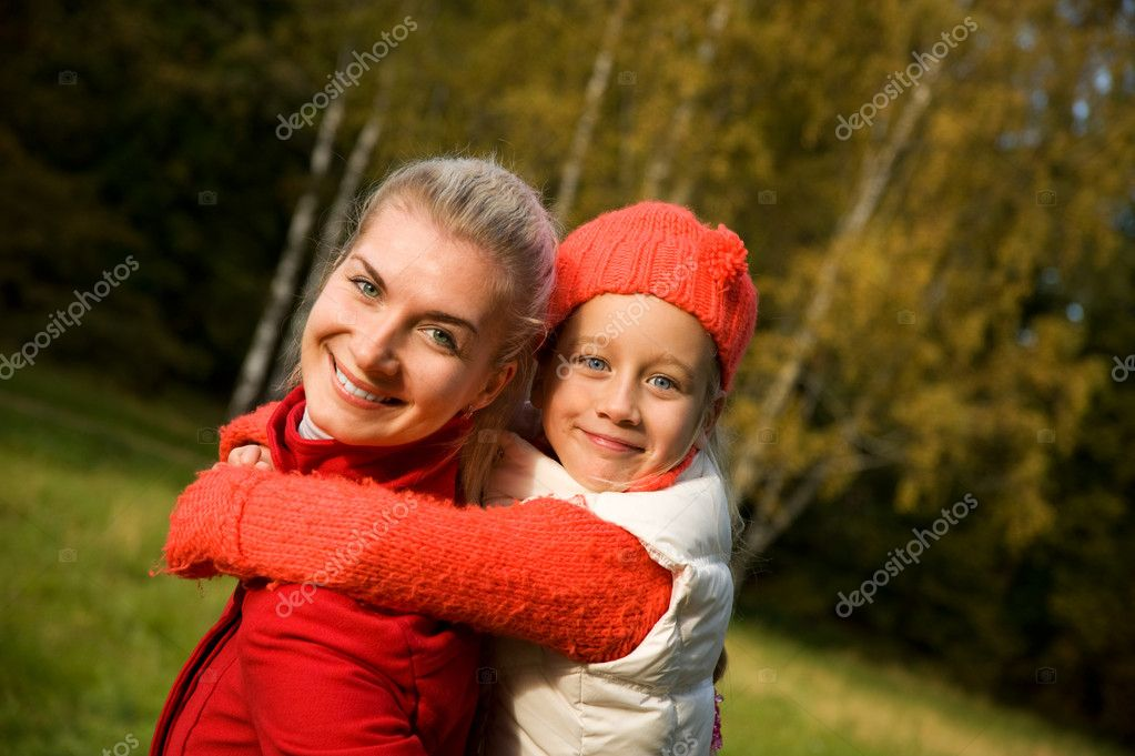 Mother and daughter outdoors  Stock Photo #1421143