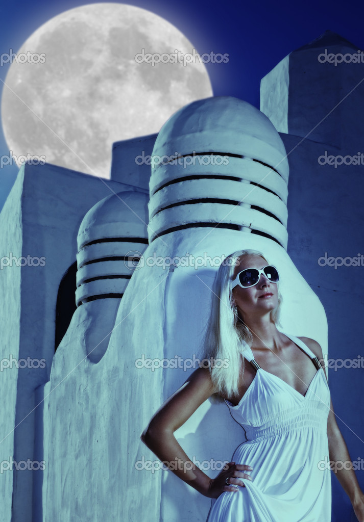 Attractive blond woman at midnight outdoors  Stock Photo #1421720
