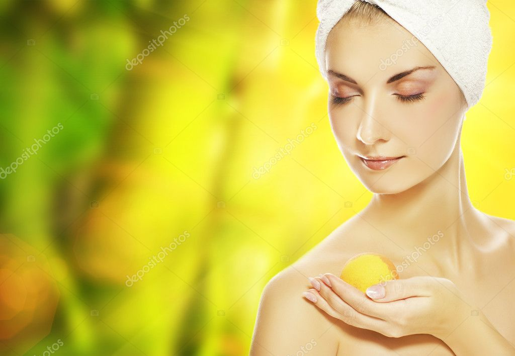 Beautiful young woman with aroma bath ball  — Stock Photo #1421867