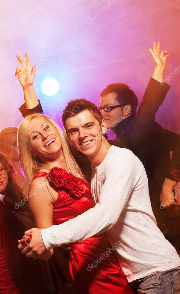 Happy couple in the night club — Stock Photo #1422953