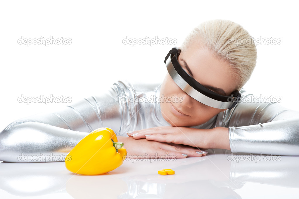 Cyber woman choosing between sweet pepper and pills — Stock Photo #1422998