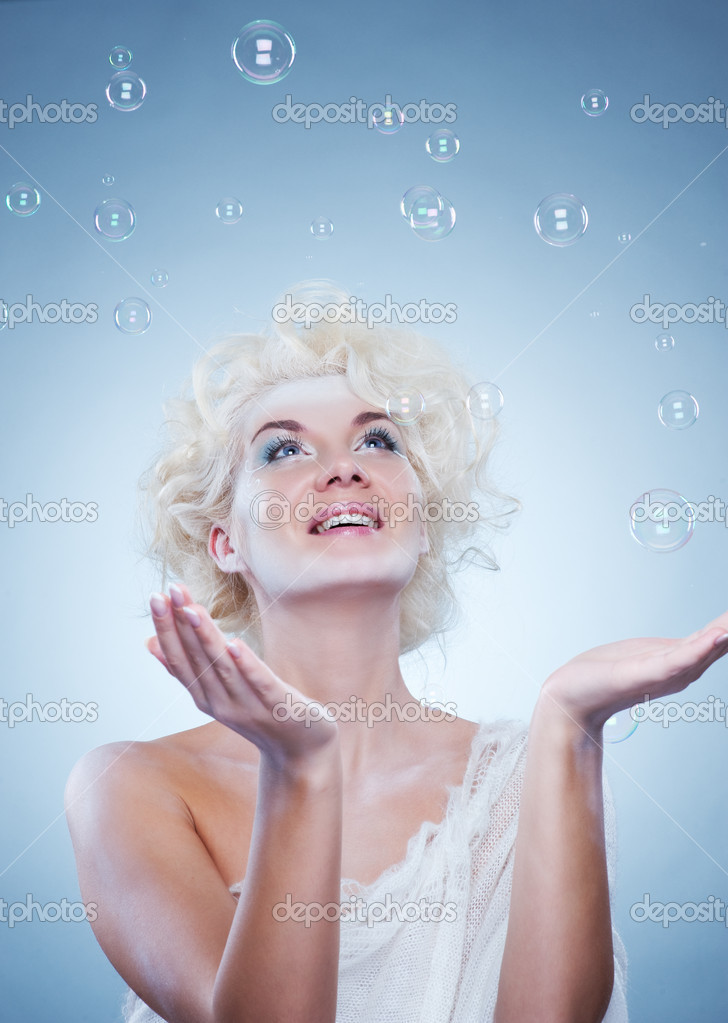 Beautiful snow queen with a foam bubbles — Stock Photo #1423051