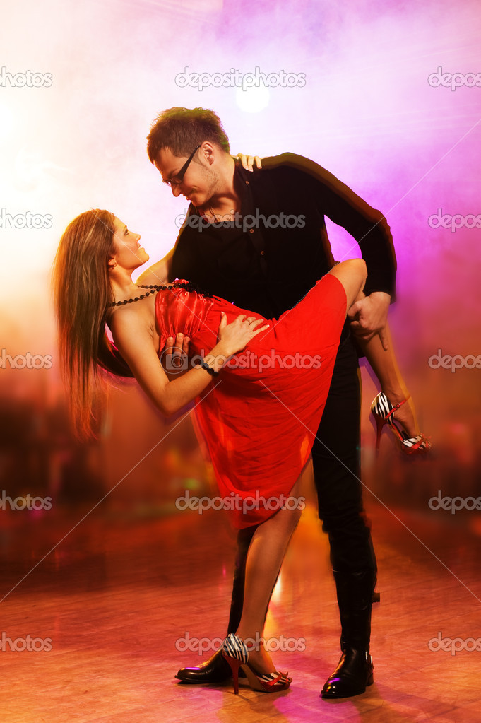 Young couple dancing in the night club — Stock Photo #1423061