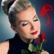 Charming lady with red rose — Stock Photo #1728016
