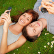 Couple with mobile phones outdoors - Stock Photo