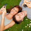 Couple with mobile phones outdoors — Stock Photo