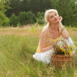 Young woman relaxing on a meadow - Stock Photo