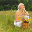 Happy girl relaxing on a meadow — Stock Photo #1728279