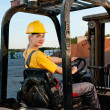 Female worker driving cargo truck — Stock Photo