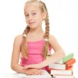Little schoolgirl sitting on books — Stock Photo #1728401