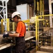 Factory loader at work - Foto de Stock  