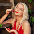 Beautiful woman with strawberry — Stock Photo