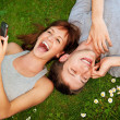 Stock Photo: Couple with mobile phones outdoors