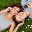 Couple with mobile phones outdoors — Stock Photo #1728776
