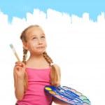 Beautiful little girl painting — Stock Photo #1729695