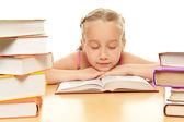 Little schoolgirl fall asleep — Stock Photo