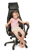 Young girl sitting on chair — Stock Photo