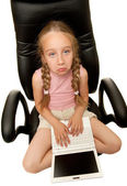 Sad young girl with laptop — Stock Photo
