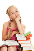 Thoughtful little schoolgirl — Stock Photo