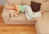 Beautiful woman sleeping on sofa — Stock Photo