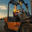 Female worker driving cargo truck - Stock Photo