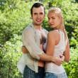young couple in love unter regen — Stockfoto