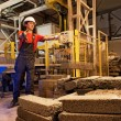Factory worker throwing defective block - Stockfoto
