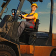 Female worker driving cargo truck - Foto Stock