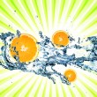 Splashing water with oranges — Stock Photo