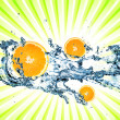 Splashing water with oranges - Stock Photo