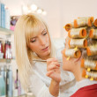 Female hairdresser working in beauty salon — Stock Photo