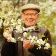 Happy elderly man in the garden — Stock Photo #1741153