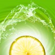 Lime slice on abstract background - Stock Photo