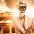 Beautiful woman in front of Colosseum — Stock Photo #1741454