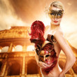 Beautiful woman in front of Colosseum — Stock Photo #1741623