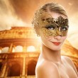 Beautiful woman in front of Colosseum — Stock Photo