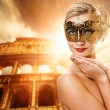 Stock Photo: Beautiful woman in front of Colosseum