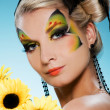 Young beauty with butterfly face-art — Stock Photo