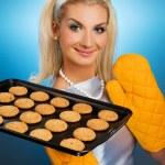 Beautiful woman holding hot roasting pan — Stock Photo #1741840