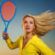 Beautiful woman playing tennis — Stock Photo #1741958
