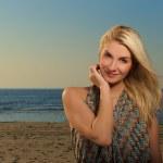 Beautiful woman on a beach at sunset — Stock Photo #1742027