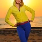 Beautiful woman on a beach at sunset — Stock Photo #1746634