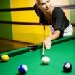 Beautiful blond woman playing billiards — Stock Photo #1746796