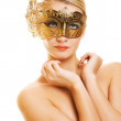 Lovely young woman with carnival mask — Stock Photo #1746840