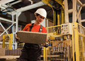 Factory loader at work — Stock Photo