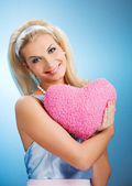Beautiful young woman with fluffy heart — Stock Photo